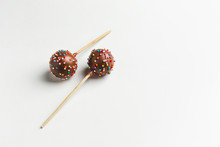 Cake Pops On Wooden Stand On W...