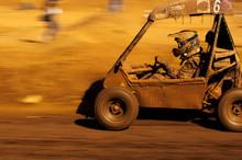 Man Driving Buggy In Desert