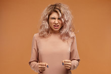 Enraged Furious Young Woman Wi...
