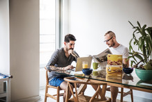 Gay Couple At Home Having Breakfast