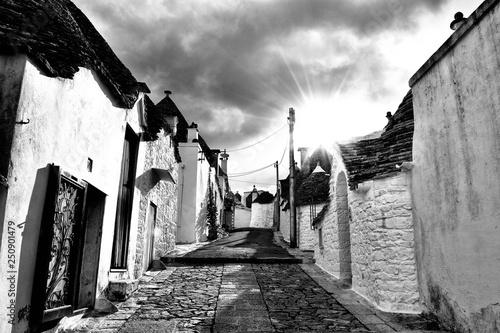 Unique Trulli houses of Alberobello, Puglia region, Italy. Black and white image.