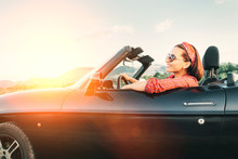 Young Cheerful Smiling Female  Driving Convertible Car At Sunny Day Time