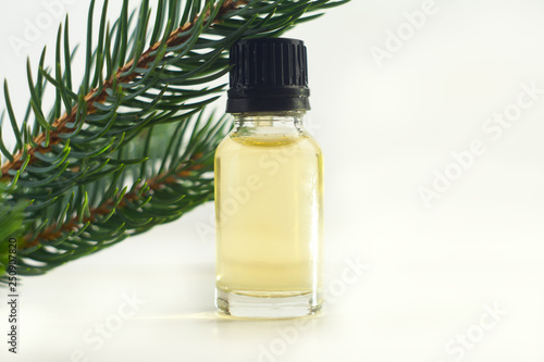 Vászonkép  Essence of pine on table in beautiful glass jar