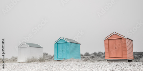 Photo Findhorn, Scotland - July 2016: Colourful beach huts along the coast at Findhorn