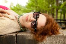 Girl In Sunglasses Lying On Wa...