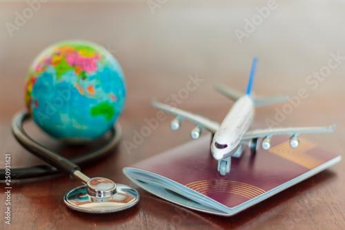 Fotografia  Stethoscope , passport document, airplane and globe