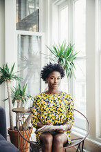 Portrait Of Young Businesswoman Sitting In Office
