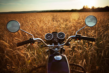 Motorcycle Against Wheat Field