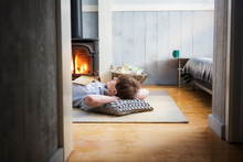 Man Relaxing On Floor By Firep...