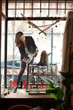 Woman Arranging Store Window Display