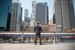 Man looking at city buildings