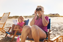 Grandmother And Granddaughter (4-5) On Beach