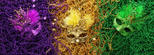 Purple, Gold, And Green Mardi Gras Beads And Masks Background