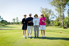 Portrait Of Four Female Golfers On Golfcourse