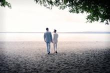 Men In Suits On Beach