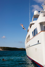 Man Jumping Off Yacht
