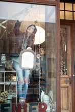Woman Working In Antique Shop