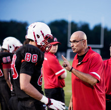 Coach Talking With Football Players (16-17)