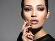 Leinwandbild Motiv Face of a beautiful girl with fashion makeup and black nails