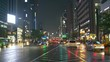 wet busy road in downtown Seoul