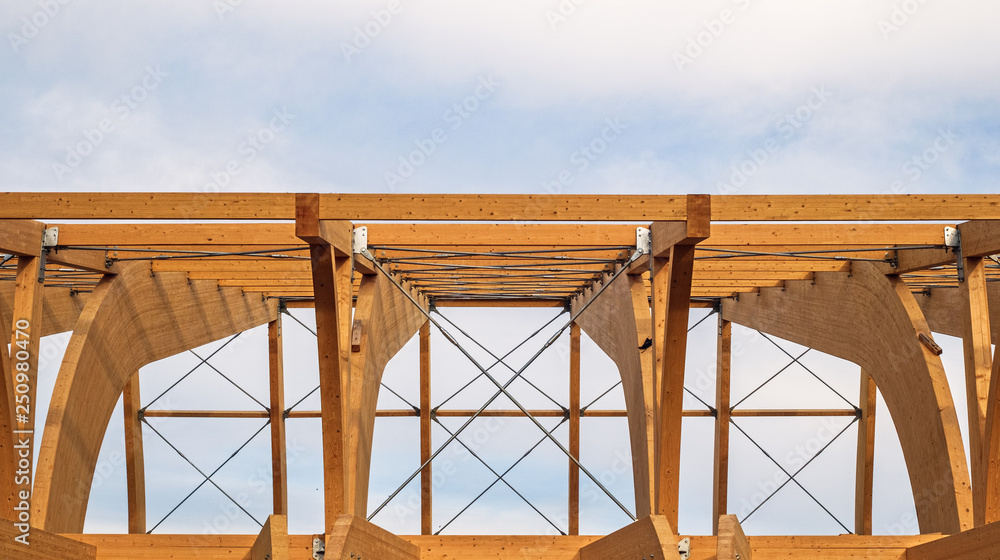 Fototapety, obrazy: Detail of a modern wooden architecture in glued laminated timber on a blue cloudy sky