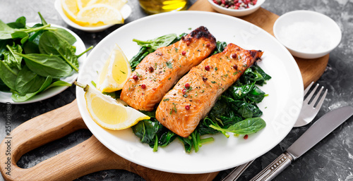 Leinwand Poster Salmon fillet with spinach .