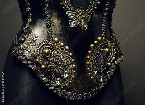 Fotografie, Obraz  Gorgeous golden corset with precious stones