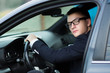 close up.successful young businessman sitting behind the wheel of a car.