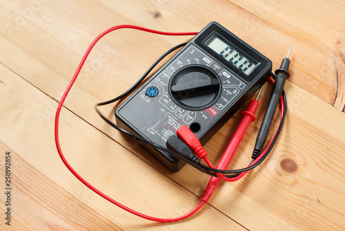 digital multimeter and wiring on wooden table. special tools ... on wiring contractors, clutch works, electronics works, floor works, painting works, fabrication works, pump works, motor works,