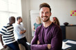 Leinwandbild Motiv Smiling young designer standing in an office after a presentatio