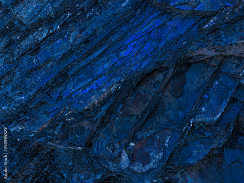 Photo sur Toile Les Textures stone texture of amazing color, rocky layers of bright colors
