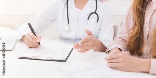 Doctor writing in clipboard patient's anamnesis, copy space Canvas Print
