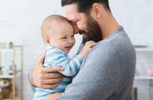 Loving Father Embracing His Cu...