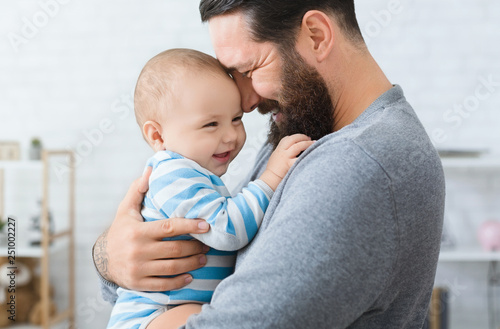 2bd1784f Loving father embracing his cute baby son - Buy this stock photo and ...