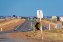 Endless Straight Road Through Dry Farmland In Australian Outback