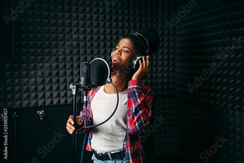 Female performer songs in audio recording studio - 251005457