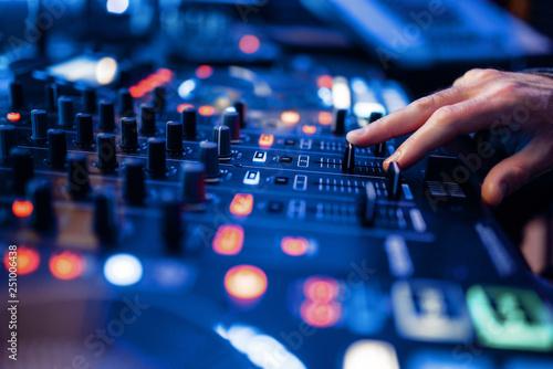 Fotografie, Obraz  Sound operator hands at the volume control panel