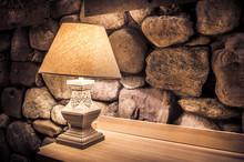 Stone Wall And Stylish Lamp