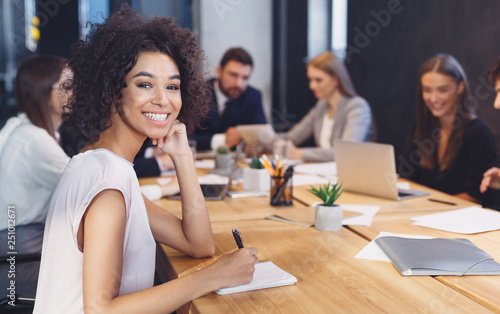 Fotografía  African-american businesswoman smiling at camera at meeting
