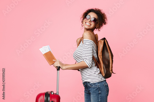 Foto  Travelling abroad. Happy tourist woman with passport