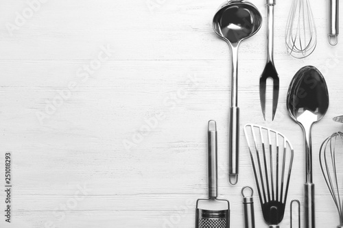 Different kitchen utensils on wooden background, top view with space for text Canvas Print