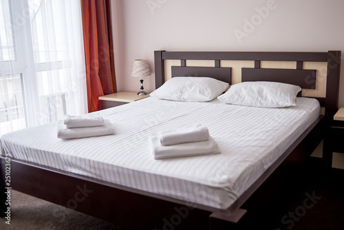 sale retailer 4c4bd d7e89 Hotel bedroom interior with empty double bed with wooden ...