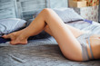 Portrait of beautiful woman legs,wearing at gray  panties!