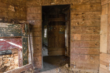 Doorway In Long Forgotten Abandoned Wood Paneled Farmhouse
