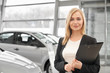 Woman working in car dealership as manager.