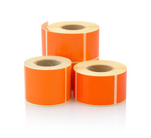 Orange Label Roll Isolated On White Background With Shadow Reflection. Color Reel Of Labels For Printers. Labels For Direct Thermal Or Thermal Transfer Printing. Orange Stickers.