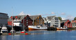 Leinwanddruck Bild - Historic harbor with cutter, sailboat and colorful storage buildings in the old town of Tromso, Norway