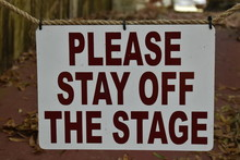 Please Stay Off The Stage Sign