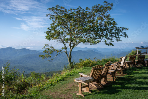 Scenery looking Rocking Chairs on Mountain Side