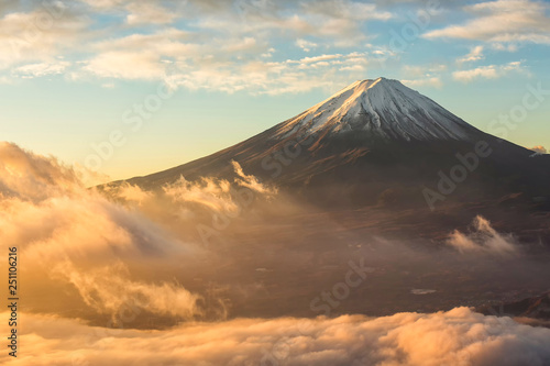 Fotografie, Obraz Fuji mountain and the mist over Lake Kawaguchiko at beautiful sunrise , Yamanashi, Japan, Mount Fuji or Fujisan located on Honshu Island, is the highest mountain in Japan